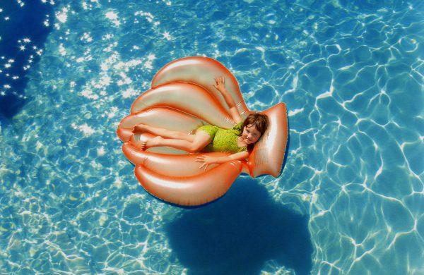 Girl Wearing Green Wet Suit Riding Inflatable Orange Life 755042